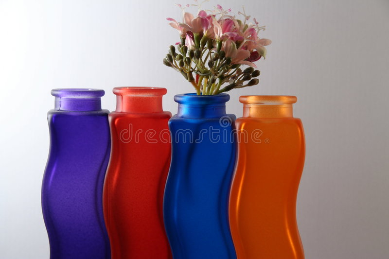 Glass bottles. Some colors of original bottles royalty free stock photos