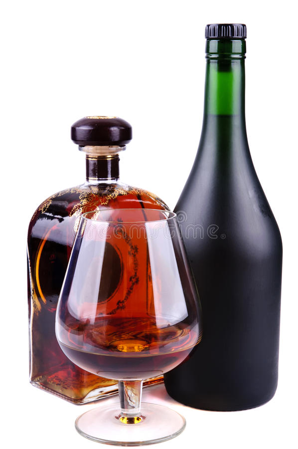 Glass and bottles of brandy stock photo