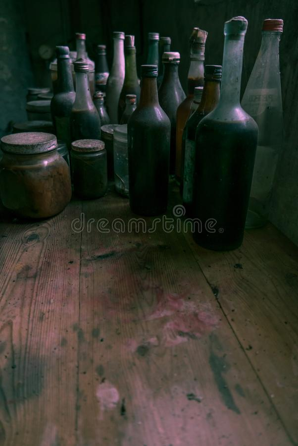 Glass bottles in an old kitchen. Lots of room for text. royalty free stock photo