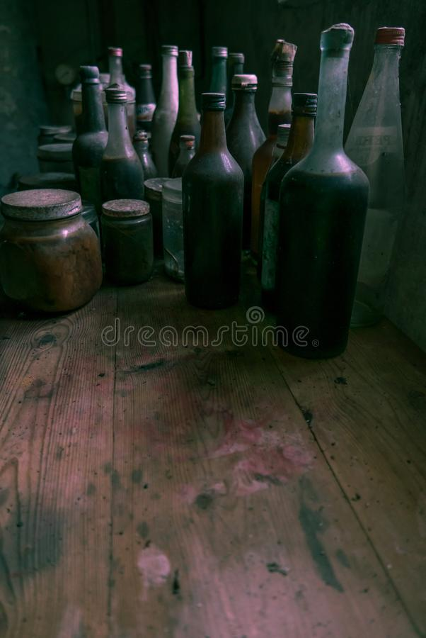 Glass bottles in an old kitchen. Lots of room for text. royalty free stock photos