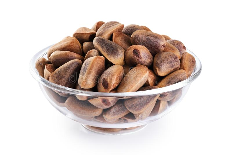 Glass bowl with cedar pine nuts  isolated on white background. With clipping path stock images