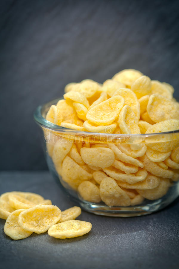Glass bowl of chips or crisps stock image