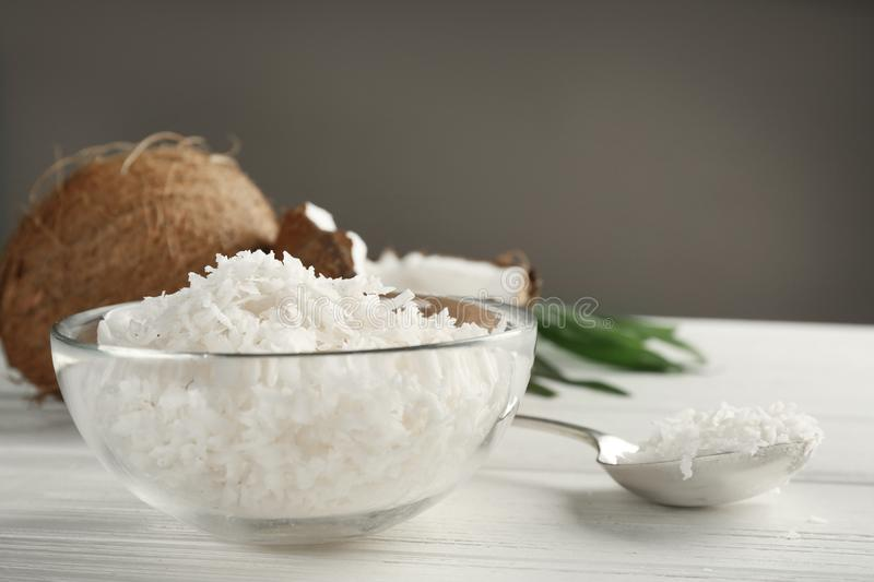 Glass bowl with coconut flakes royalty free stock images