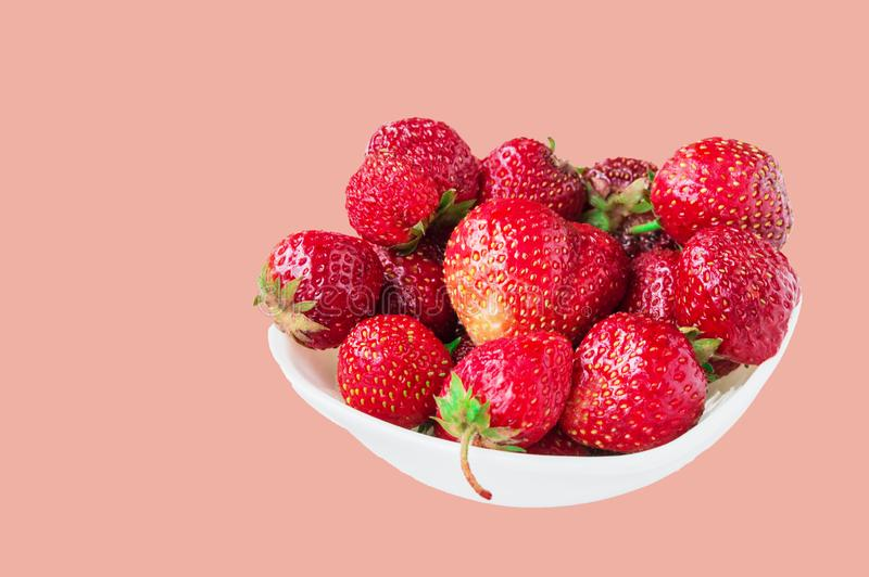 Glass bowl with fresh ripe strawberries, space for text, copy space isolated on pink background, layout, clipping. Summer, outdoor, strawberry, fruit royalty free stock photography