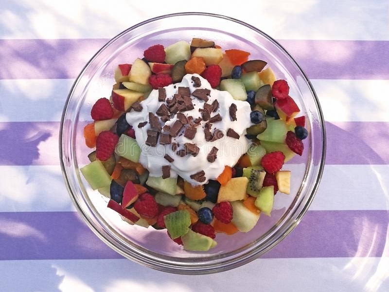 Glass bowl with fruit salad and yogurt royalty free stock images