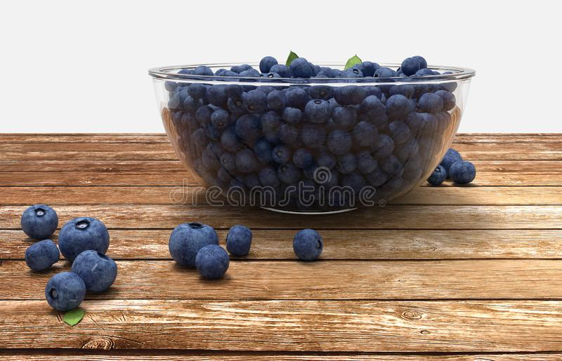 Glass bowl full of blueberries on wooden table royalty free stock photos