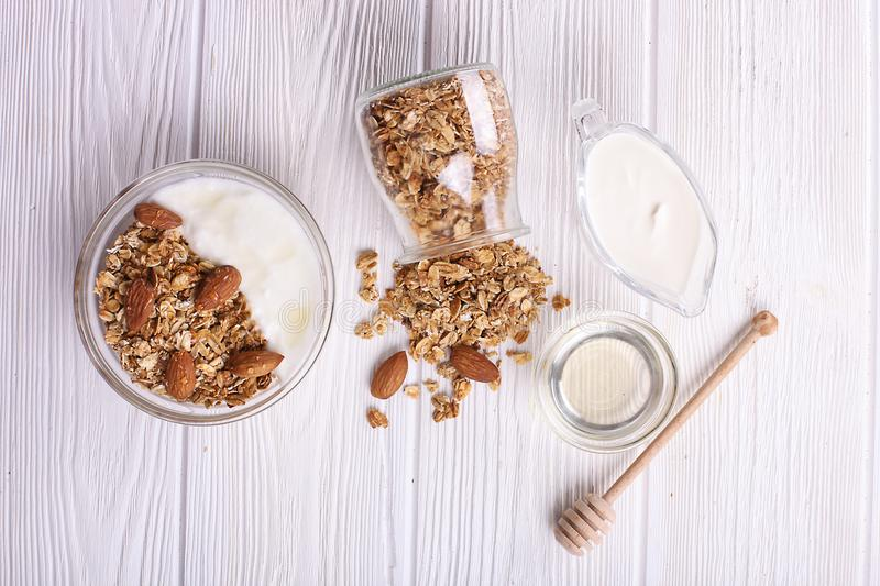 Glass bowl with Greek yogurt and mixed nuts. Healthy vegetarian protein rich diet, homemade granola breakfast with milk, almond, c stock images
