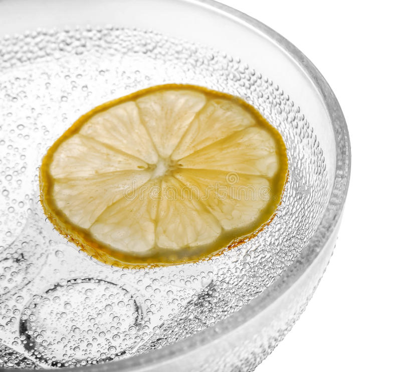 Glass bowl with lemon and bubbles stock image