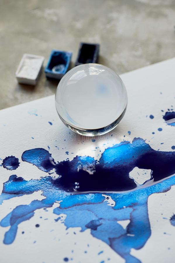 Glass bowl and reflection in blue ink puddle.Abstraction. Glass bowl and reflection in blue ink puddle. Abstraction stock photography