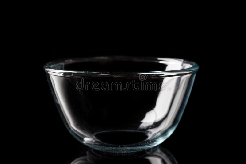 Glass bowl from side on black royalty free stock photo