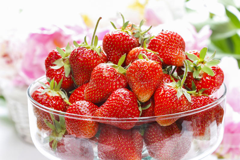 Glass bowl of strawberries. Festive and party dessert stock images