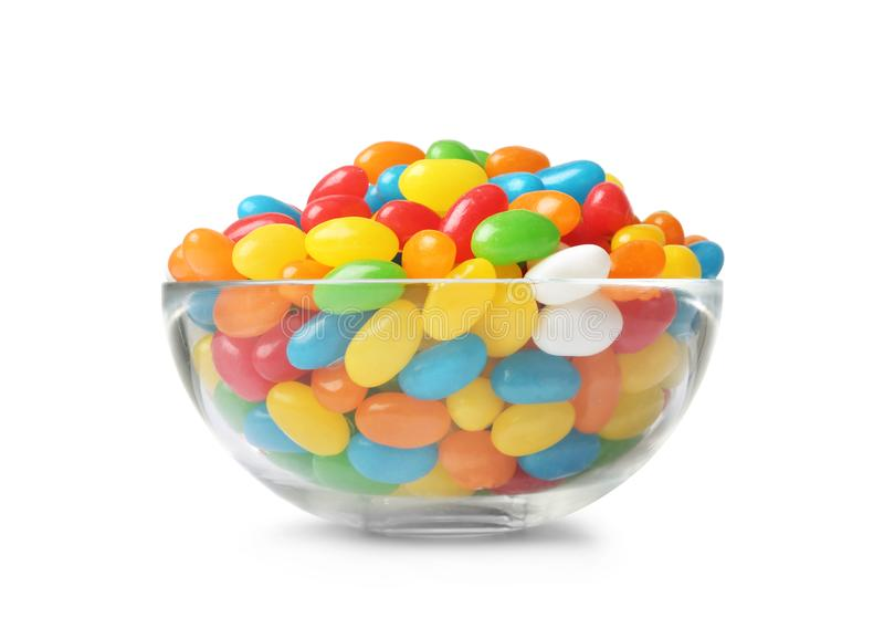 Glass bowl of tasty bright jelly beans isolated. On white royalty free stock image