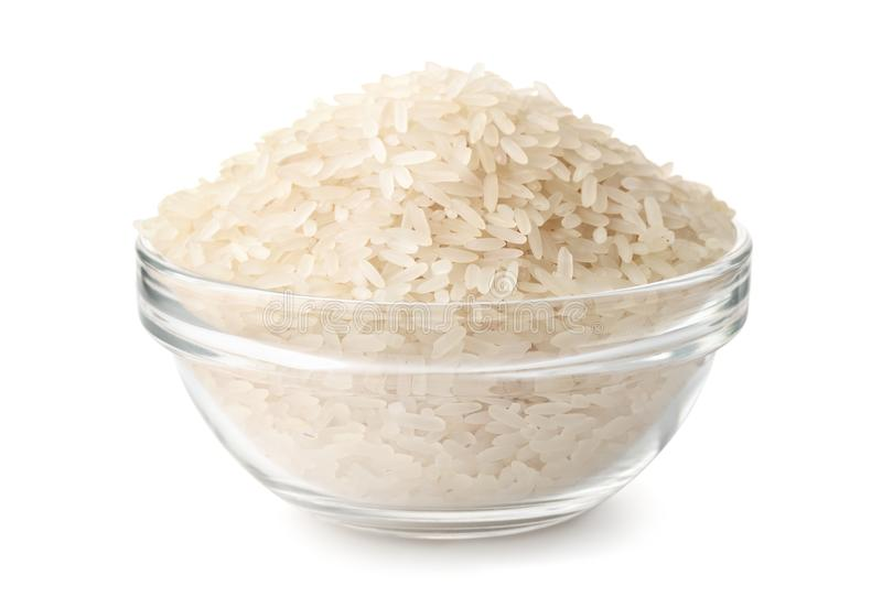 Glass bowl of uncooked dry rice stock photos