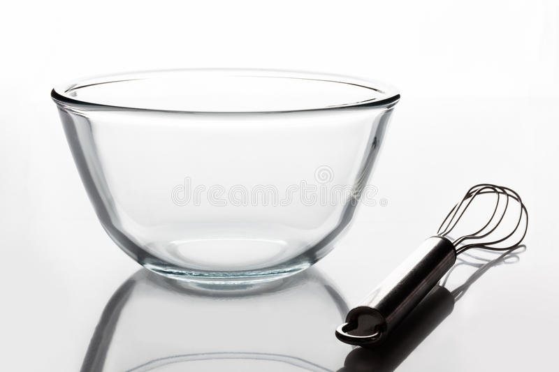 Glass bowl with whisker from side stock photo