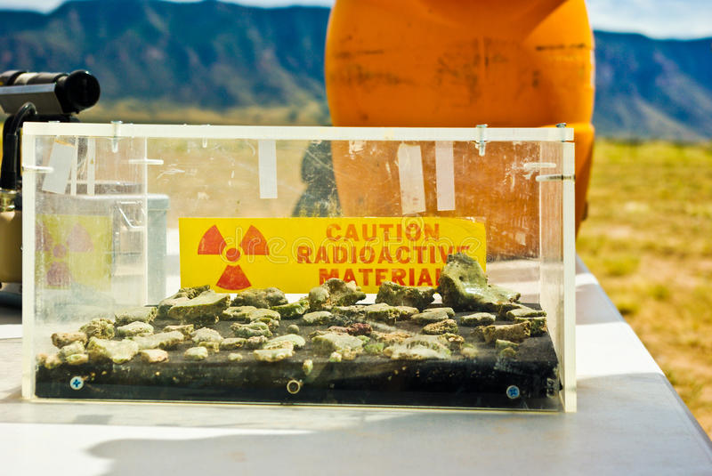 Glass box of radioactive material. That contains trinitite - glassy residues of nuclear bomb testing stock photography