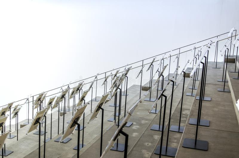 Glass Brand on Cement Steps. There are many glass plates with iron shelves on the cement steps stock photo