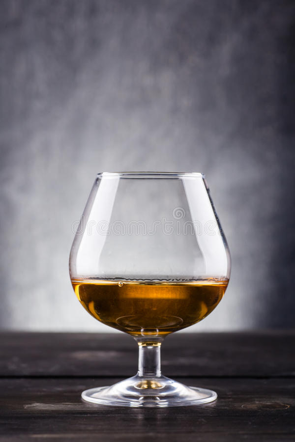 Glass of brandy stock images