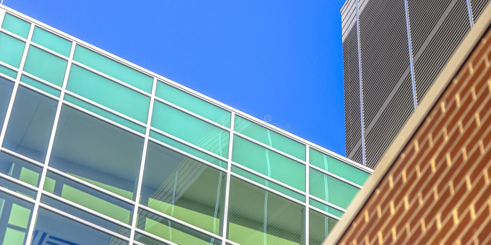 Glass and brick building in sunny Salt Lake City stock photos