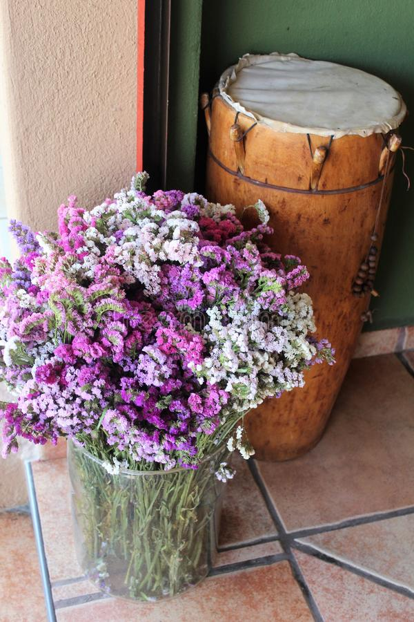 Glass bucket of white and lavendar flowers stock images