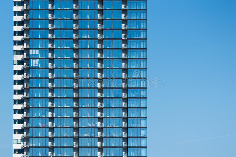 Glass building in blue sky stock photos