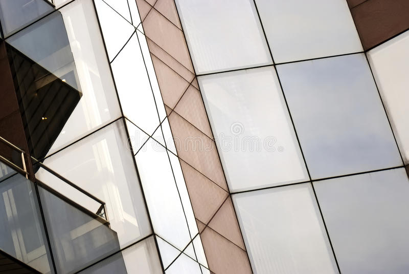 Glass building, city's modern realty... Quality photo of a modern European street building geometric design (living house). Really new, multicolor glass design stock image