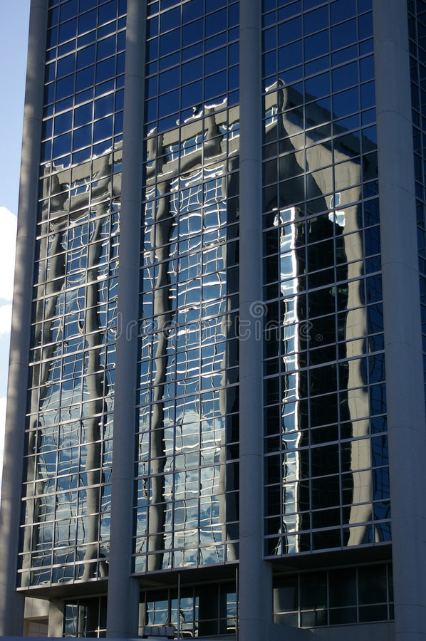 Glass building with reflection royalty free stock photos