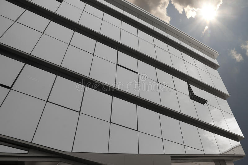 Glass building and sun stock photo