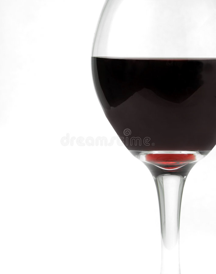 Glass of Burgundy Wine. A glass of burgundy wine against a white background stock images