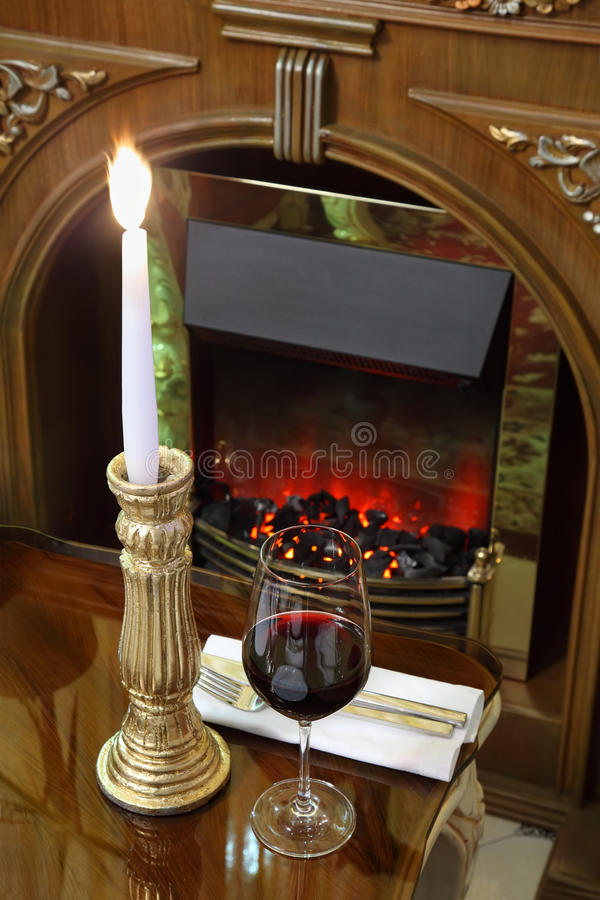 Download Glass and burning candle stock photo. Image of dish, drink - 25095600