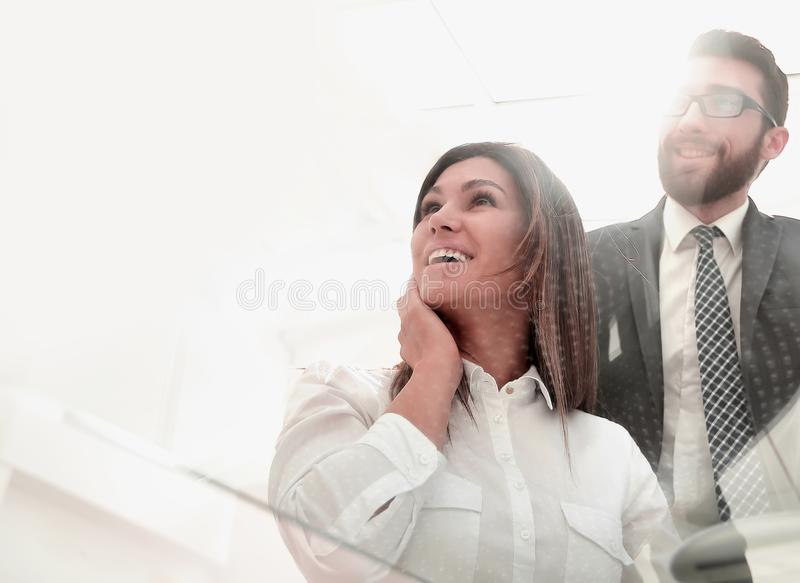 Through the glass.business colleagues at the Desk stock photography
