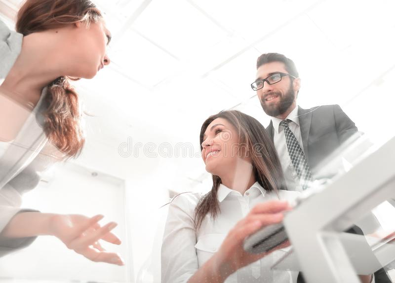 Through the glass.business colleagues at the Desk royalty free stock image