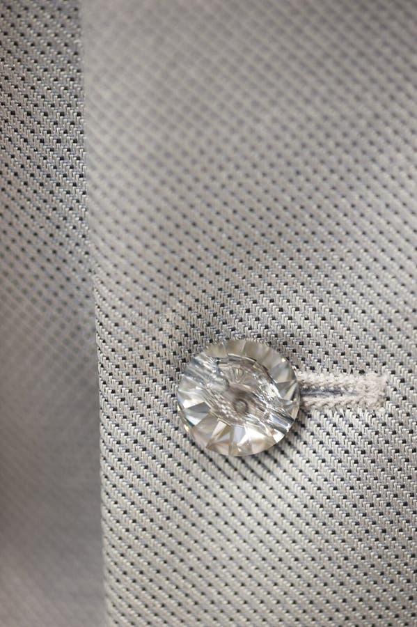 Glass button wedding dress. Glass button detail on man wedding dress stock photography