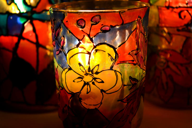 Glass candlestick painted stained glass paints. Close-up macro stock photography