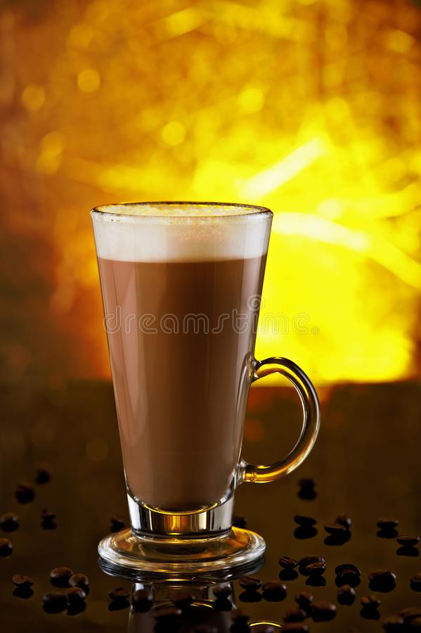 A glass of cappuccino on a black table stock photo