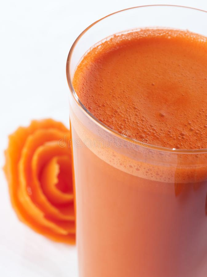 A glass of carrot Juice close up royalty free stock photography