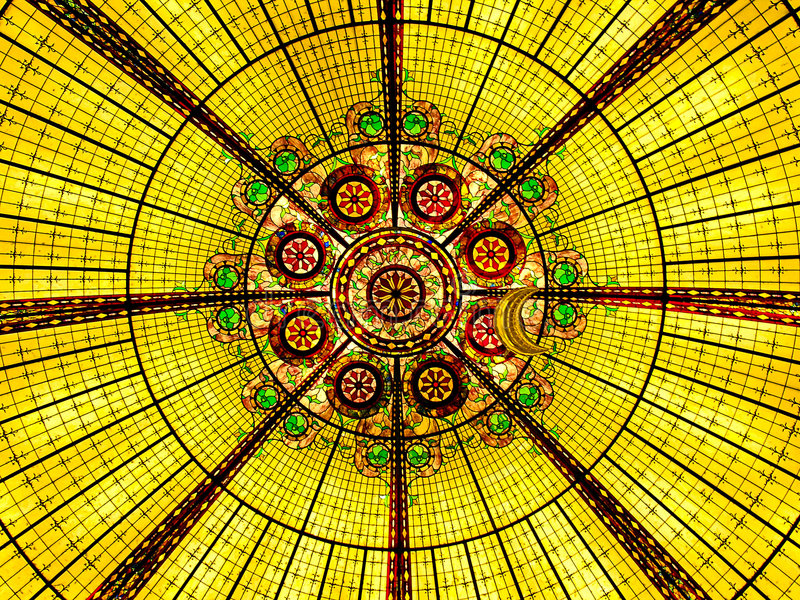 Glass Ceiling. A colorful glass ceiling presents a kaleidescope effect stock photography