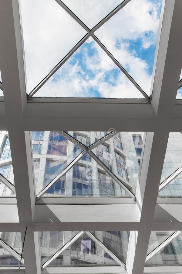 Glass ceiling with window. Shopping center, business center royalty free stock photo