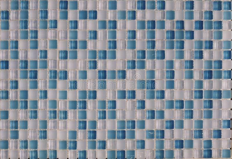 Glass ceramic multi-colored tiles of white and blue elements royalty free stock images