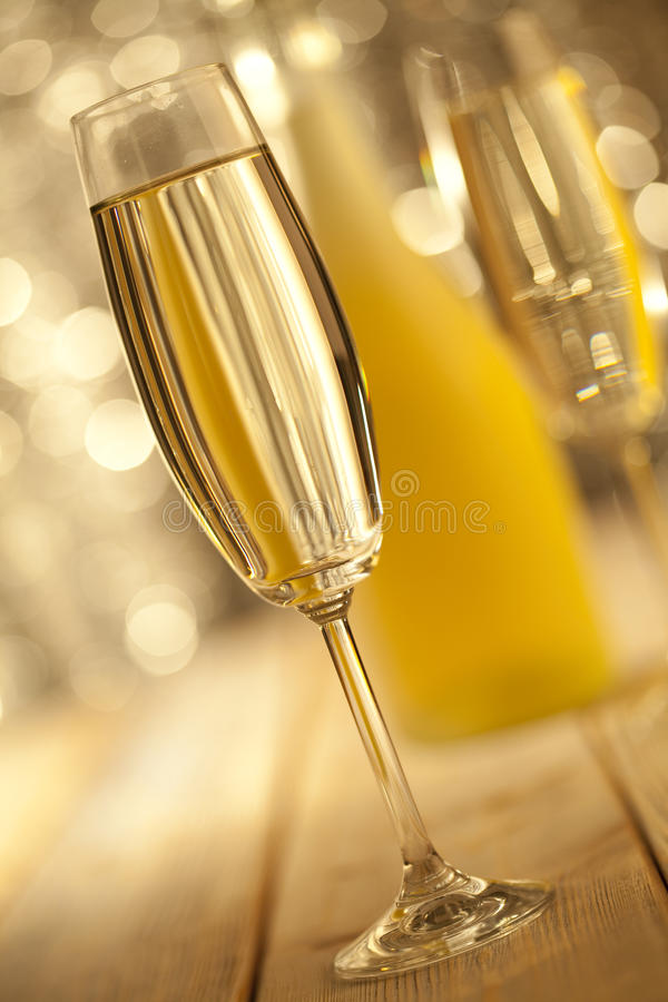 Glass of champage on bokeh background stock photo