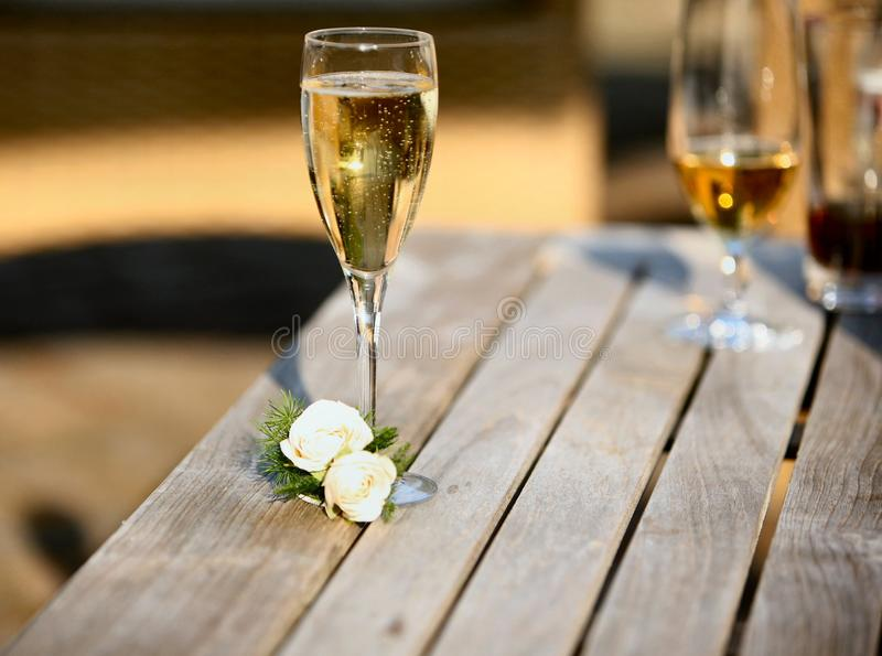 Glass of Champagne. With a button hole royalty free stock photos