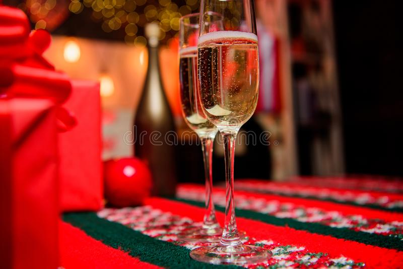 Glass of champagne close up. Champagne couple glasses. Glass filled sparkling wine or champagne near gift boxes. Cheers. Concept. New year traditional attribute royalty free stock photos