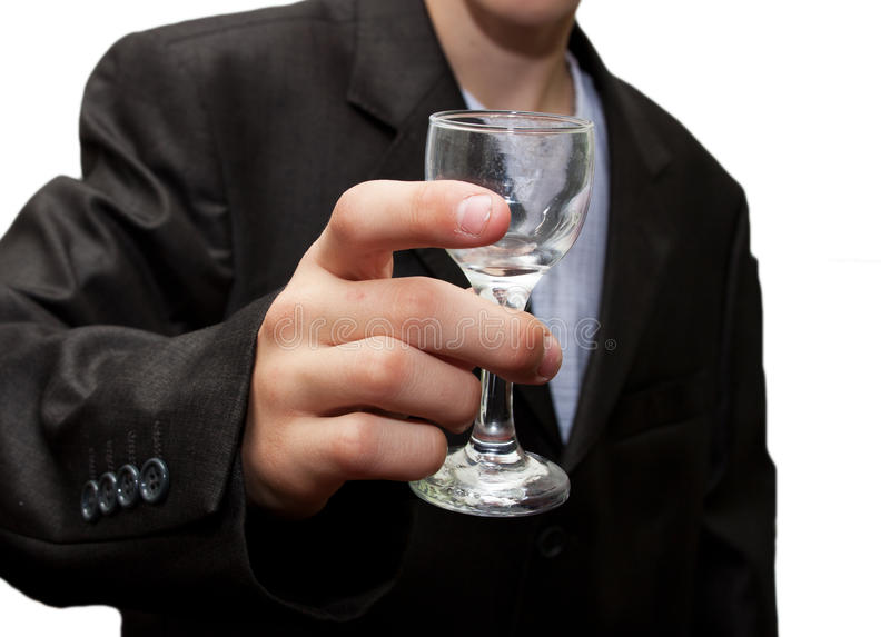 Glass of champagne in his hand. A businessman royalty free stock photos