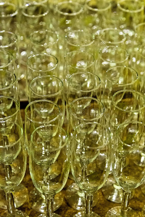 Glass champagne stemware. Empty glass stemware on a high stem for champagne or wine royalty free stock image