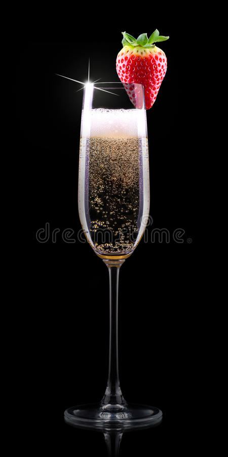 Glass of champagne with tasty strawberry. Glass of champagne with tasty red strawberry isolated royalty free stock photography