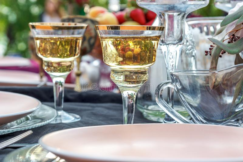A glass of champagne at the wedding table stock photos