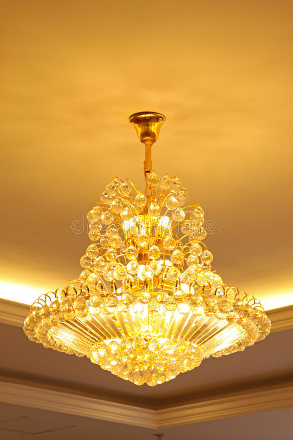 Glass chandeliers. Hanging from the ceiling stock photos