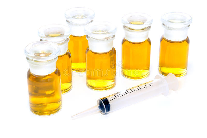Glass Chemical Bottles and Syringe stock image