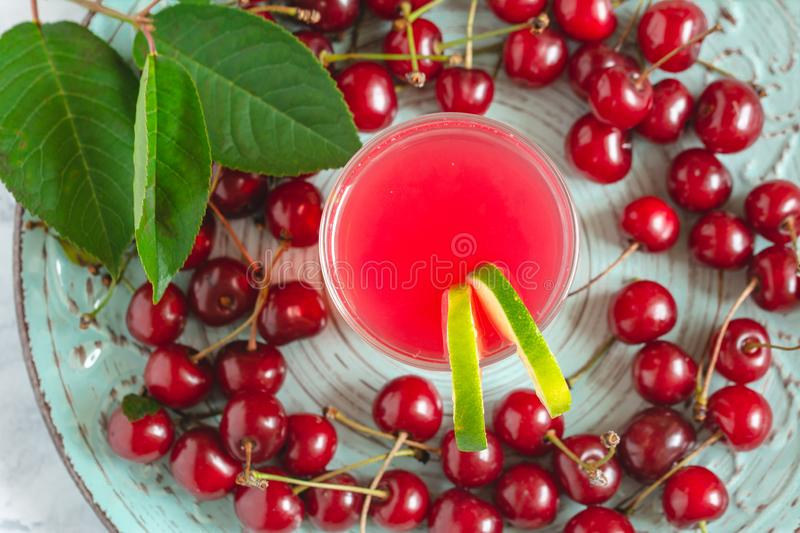 Glass with cherry compote stock image