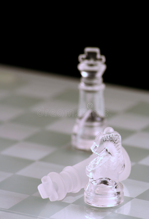 Glass chess king and knight. Close up stock photos