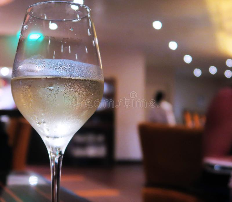 Glass of Chilled Wine Blurred Background stock images